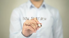 How To Reach Engagement  , man writing on transparent screen Stock Footage
