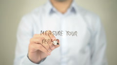 Measure Your Performance , man writing on transparent screen Stock Footage