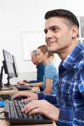 Mature Man Attending Computer Class - stock photo