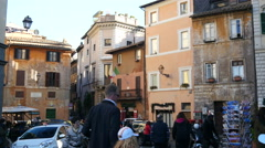 People tourists walk on cozy squares and streets of Rome Italy Stock Footage
