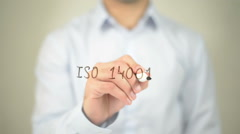 ISO 14001, man writing on transparent screen Stock Footage