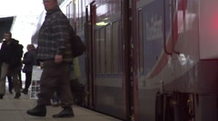 Railway station, male and female tourists leaving and boarding train, traveling Stock Footage