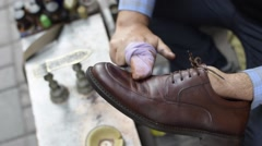 Shoe shiner work on street and polishing brown shoes, close up Stock Footage