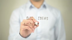 Big Ideas Bigger Results  , man writing on transparent screen - stock footage