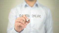 Do You Speak French  ? , man writing on transparent screen Stock Footage