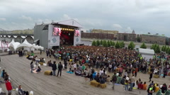 People enjoying music at outdoor concert, aerial view Stock Footage
