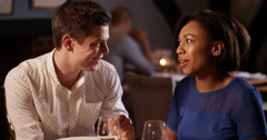 4K Romantic couple in a restaurant, chatting and enjoying each other's company Stock Footage