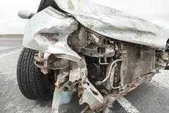 broken car after the accident in  foreground - stock photo