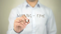 Warning - Time waster Ahead, man writing on transparent screen Stock Footage