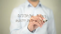 Discipline Turns Ability into Achievement, man writing on transparent screen Stock Footage