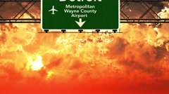 4K Passing Detroit Airport USA Highway Sign in the Sunset 2 Stock Footage