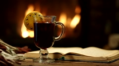 Glass of mulled wine on a background of fireplace. Stock Footage