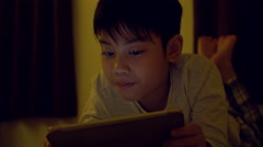 Young asian child playing game on mobile phone, Stock Footage