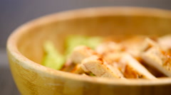 Home Preparing Caesar Salad In Wooden Bowl - stock footage