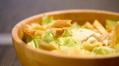 Home Preparing Caesar Salad In Wooden Bowl Stock Footage