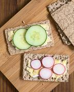 Wholemeal Rye Crispbread with Brie, Radish and Cucumber - stock photo