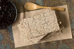 Wholemeal Rye Crispbread with Jam - stock photo