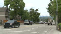 Busy traffic top of hill going into small city Stock Footage
