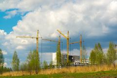 Construction multistorey apartment houses in natural landscape - stock photo
