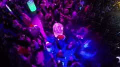 People on dance floor in the club, aerial view - stock footage