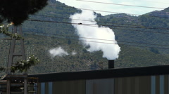 evaporative emissions and industrial smoke from a chimney of a steel plant - stock footage