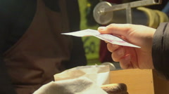 Person buying fresh hot pastry at celebration event, street food, slowmotion Stock Footage