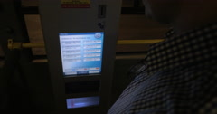 Man taking ticket from machine in the bus Stock Footage