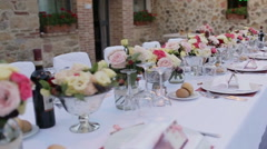 Pan view of luxury restaurant table setted for wedding celebration - stock footage