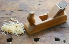 Planer with sawdust on the Workbench - stock photo