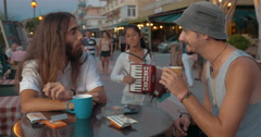 Gipsy girl playing accordion in street cafe to get money Stock Footage