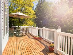 Bright daylight falling on home outdoor deck - stock photo