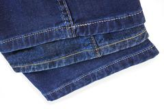 Bright thread seams on blue denim trousers Stock Photos