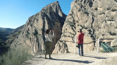 People taking photos with cellphones of El Caminito del Rey - stock footage