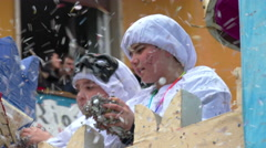 Carnival parade: children playing with confetti Stock Footage