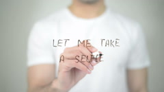 Let me Take a Selfie, man writing on transparent screen Stock Footage