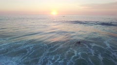 Aerial of beautiful seascape at sunset - stock footage