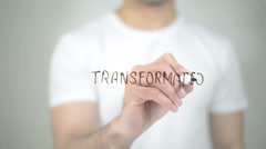 Transformation, man writing on transparent screen Stock Footage