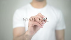 Gluten Free, man writing on transparent screen Stock Footage