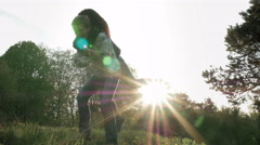 Two cheerful girls friends fools in park outdoors Stock Footage