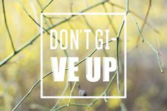 The phrase dont give up written over sad spring or autumn background Stock Photos