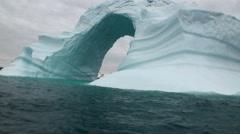 Iceberg arch like Darwin arch in Galapagos Islands Stock Footage