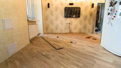Carpenter worker installing wood parquet board during flooring work timelapse Stock Footage