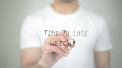 Time to Lose Weight, man writing on transparent screen Stock Footage