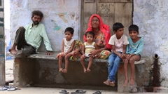 Poor Indian family sits on the street begs for money in Pushkar. India Stock Footage