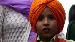Sikh boy traditional orange headscarf Stock Footage