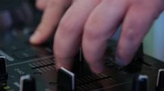 Hands DJ behind the decks - stock footage