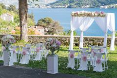 Arch for the wedding ceremony, decorated with cloth and flowers Stock Photos