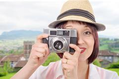 Young woman with vintage camera. youth lifestyle Kuvituskuvat