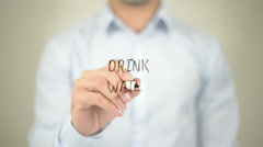 Drink Water, man writing on transparent screen Stock Footage