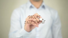 Secure Investment, man writing on transparent screen Stock Footage